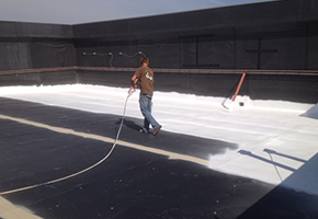 EPDM roof spraying top coat in VA