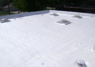 Foam roof with white top coat