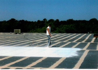 TPO roof being sprayed with top coat in IL