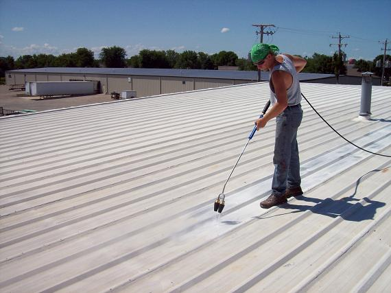 Power washing metal roof for coatings