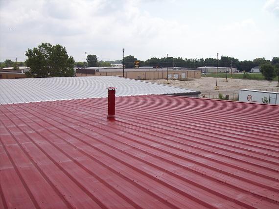 Metal roof is primed for roof coatings