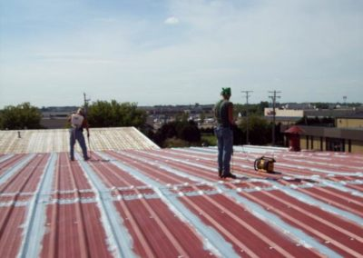Metal roof with fabric & coatings on seams WI