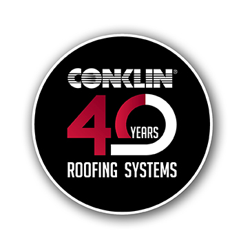 Commercial flat roof with Conklin white roof coatings