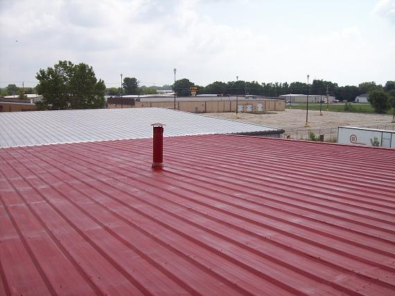 Metal roof is primed for roof coatings