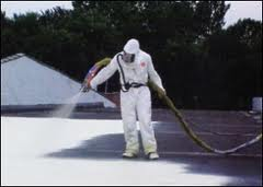 Spraying a foam roof on a commercial roof