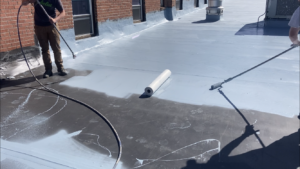 Fabric being applied to EPDM roof in Monte Vista, CO